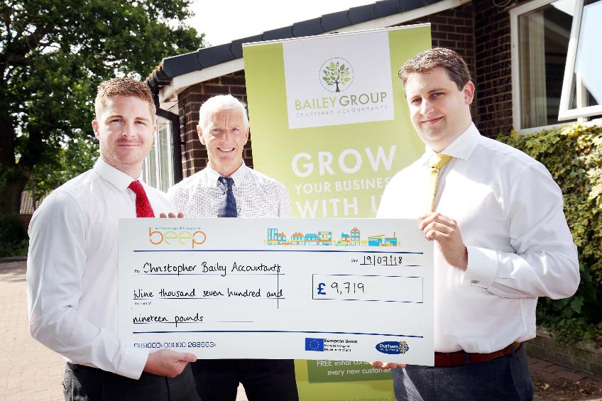 beep presenting a cheque to the bailey group accountants for £9719