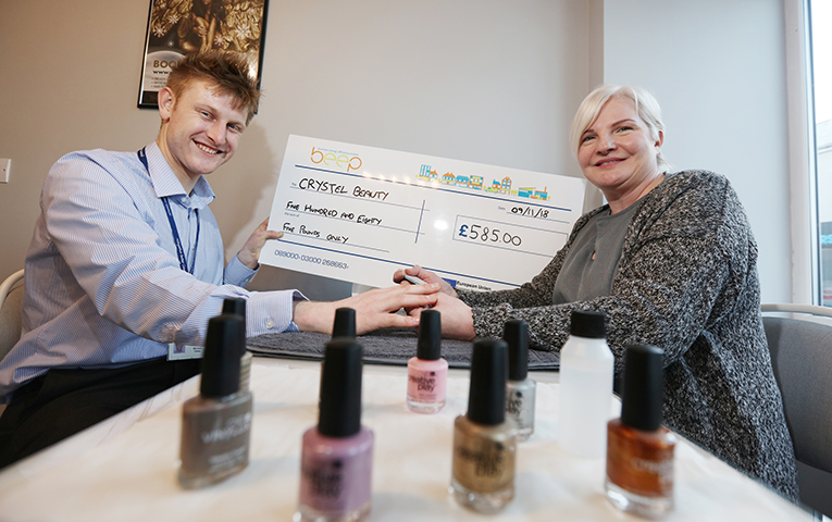 beep passing a novelty cheque to Crystal Beauty for £585