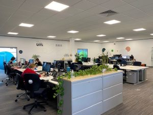 interior of Umi's bright and modern office space showing several people hard at work